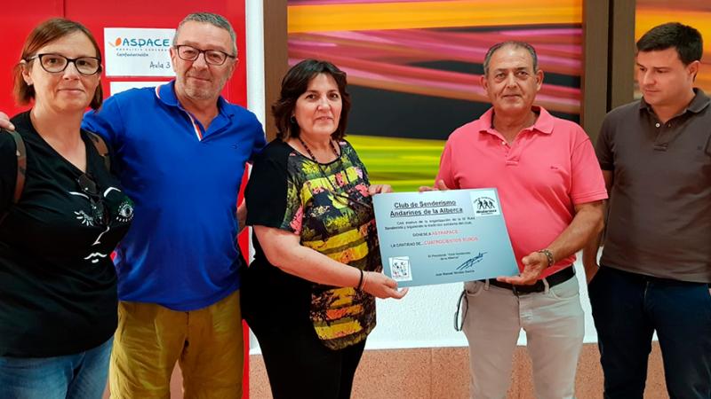 Andarines de La Alberca entregan donativo a Astrapace